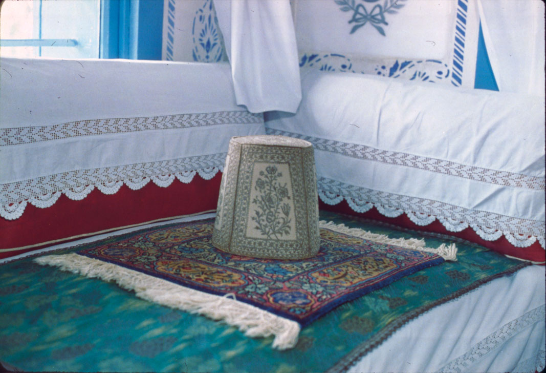Bahá'u'lláh's taj marks the spot where He sat when receiving guests in His room at Bahji.