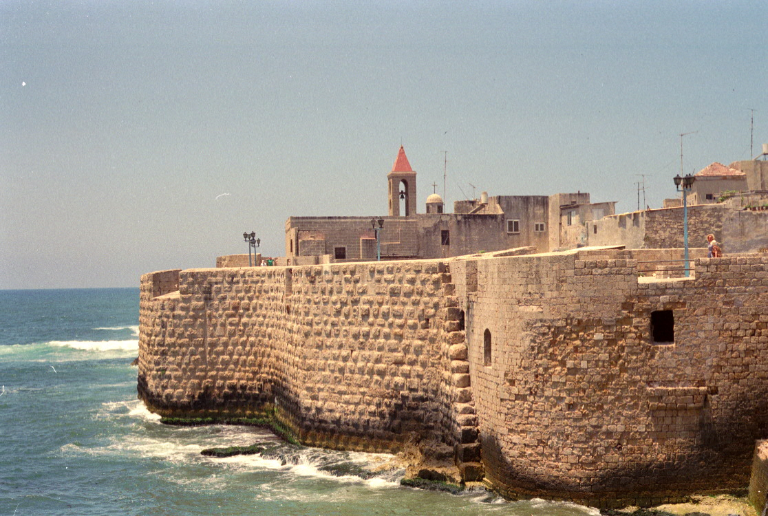 The Mediterranean Sea washes against ramparts in Akká, Israel