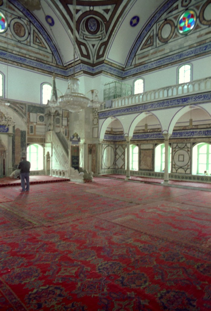 A man quietly offers his devotion to Allah in the Al-Jazzar Mosque in Akka, Israel